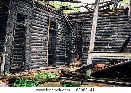 Wooden charred walls of an old abandoned burned-out mansion, Interior inside ruined broken house