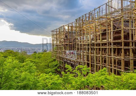 Kyoto, Japan - April 24, 2017: aerial view of Kiyomizudera Temple main hall and Kyoto cityscape. The main hall will be covered up from February 2017 to March 2020 for the renovation of its roof.