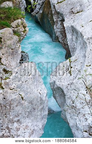 Narrow part of Soca river where you are able to jump over from one side of the river to the other
