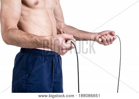 Healthy lifestyle and fitness. Naked body of a sporty guy with a skipping rope in hands isolated on white background.