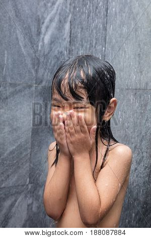 Asian Little Chinese Girl Taking A Shower