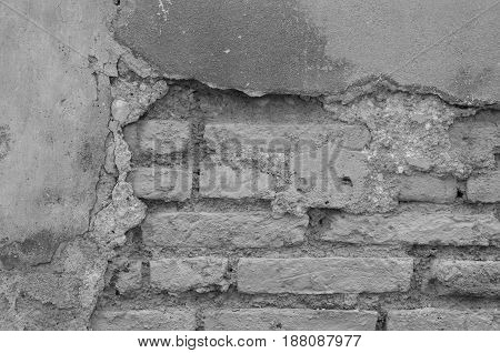 Damaged And Decay Old Brick Wall With Cement Plaster Black And White Tone