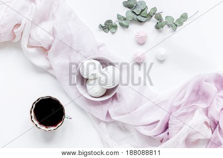 sweet lunch with marsh-mallow and spring flowers for woman on white table background top view
