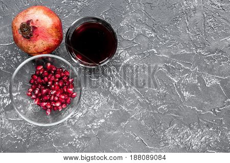 summer dessert with red juice and cut pomegranate on dark desk background top view mockup