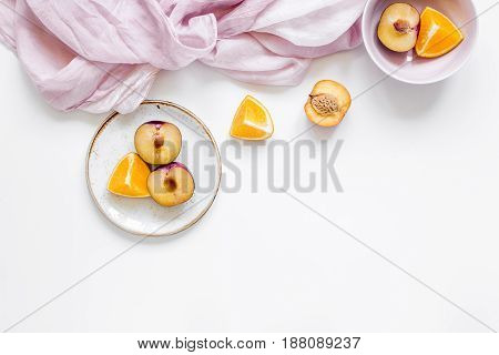 orange and peach summer sweet dessert on plates on white desk background top view mock-up