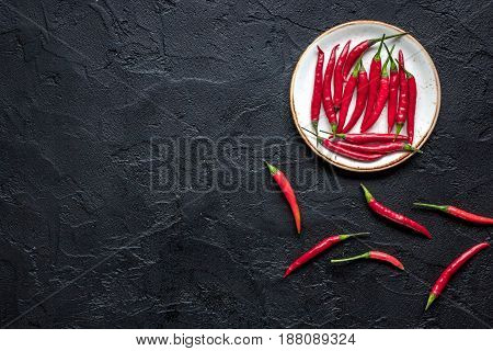 hot food with red chili pepper on dark table background top view mock-up