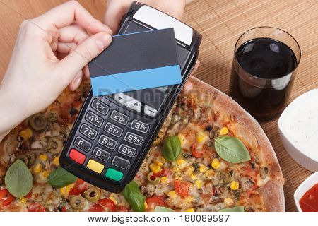Using Payment Terminal With Contactless Credit Card For Paying In Restaurant