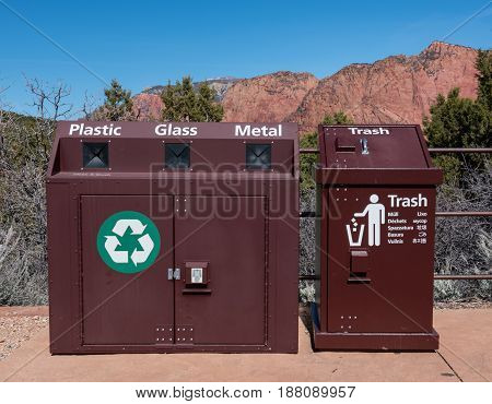 Metal Recycle Bin and Trash Can with mountains behind