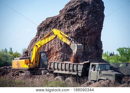Excavator Poured Cargo Into The Body Of A Quarry Truck For Transportation To The Construction Site
