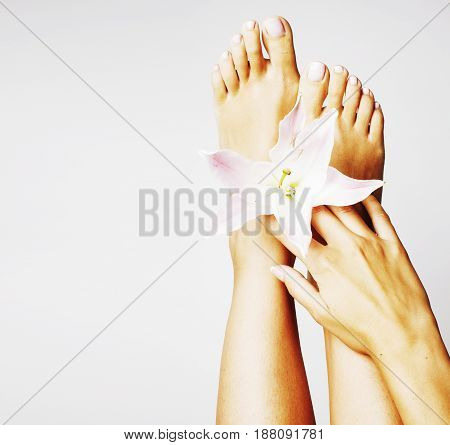 manicure pedicure with flower lily close up isolated on white perfect shape hands spa salon real