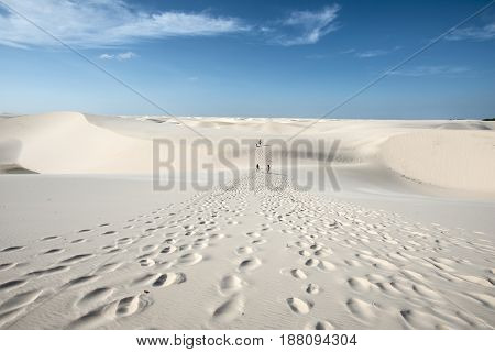 Lencois Maranhenses Brazil July 13 2016 - Tourists are going trouth Sand dunes with blue and green lagoons in Lencois Maranhenses National Park