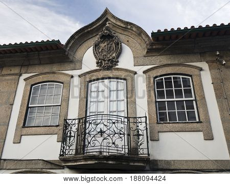 Coat of Arms carved in granite stone on top of a balcony in Arcos de Valdevez Portugal