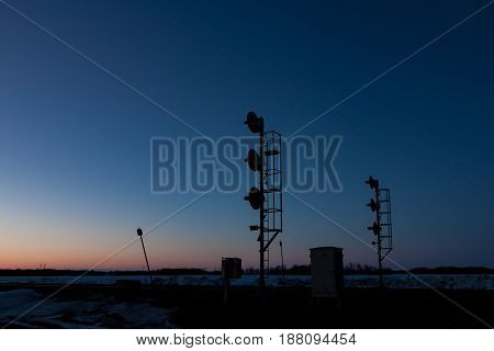 Pair of Railway Signal Silhouettes at Sunset Blue Hour