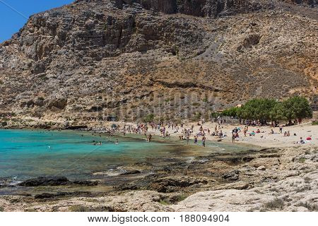 Tourists on the beach of island Imeri Gramvousa. Mediterranean Sea. Crete. Greece.