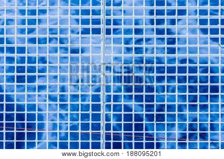 The abstract checkered background on a blue tone.