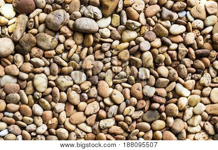 Brown gravel pebble on the floor for background texture