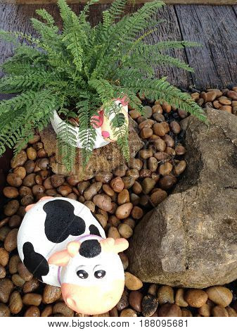Rock animal doll in the gravel garden.