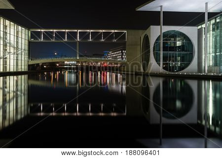 BERLIN - MARCH 05 2016: The complex of buildings in the government quarter (Regierungsviertel). Marie-Elisabeth-Lueders-Haus and Spree river at night.