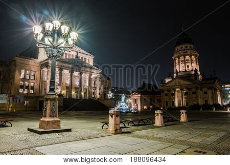 BERLIN - MARCH 05 2016: Square Gendarmenmarkt Konzerthaus and Franch Cathedral in night illumination. HDR. Toning.