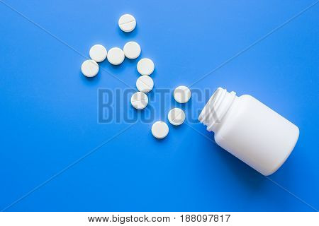 doctor's office table with white pills on blue background top view mock up