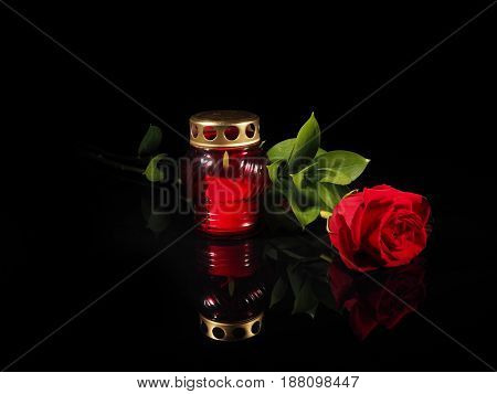 Burning Candle In A Red Glass Candlestick