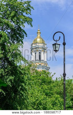 The main belfry of the Kiev Pechersk Lavra against the blue sky
