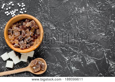 lumps and sanding sugar for cooking sweets on kitchen table background top view mock up