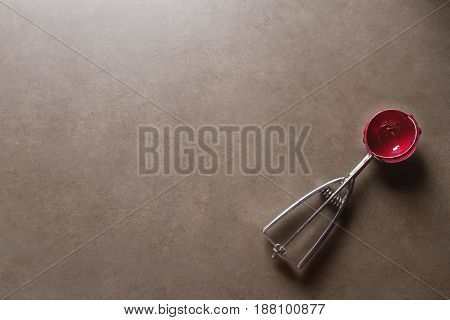 Spoon Ice Cream With Red Sorbet Lies On A Gray Table. Space For