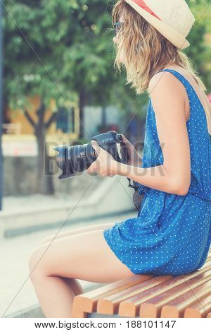 Young urban girl with a camera on the street.
