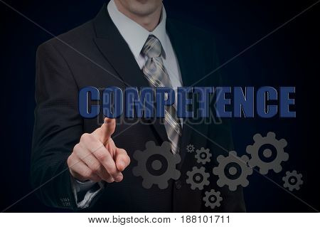 Glowing gear with icon Competence in the hands of a businessman. Business and internet concept.