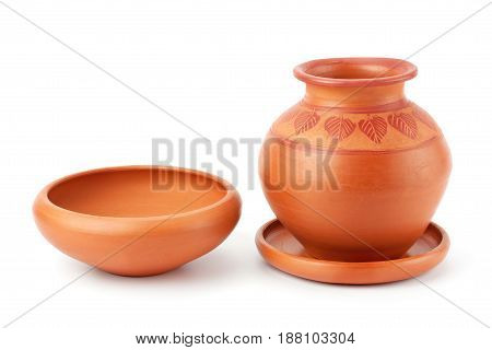 Clay pot and plate isolated on white background.