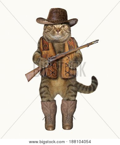 The cat cowboy is holding a real gun. White background.