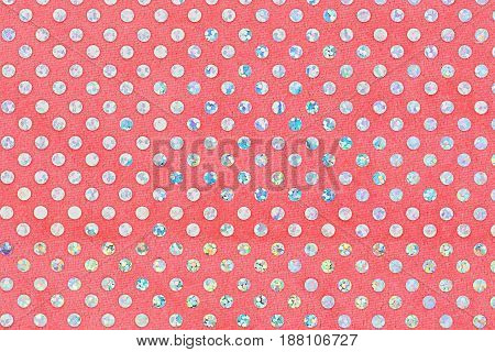 Red fabric texture with bright circles. Top view