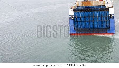 detail of big blue roro vessel in a harbour