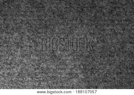 Seamless close up of monochrome grey carpet. Top view