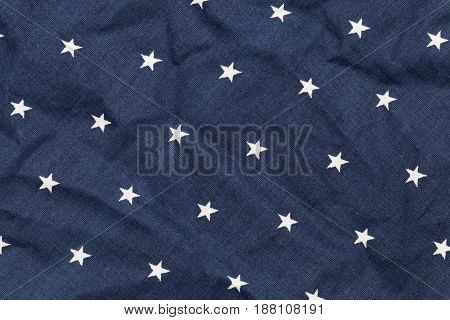 Blue fabric with white stars. Top view