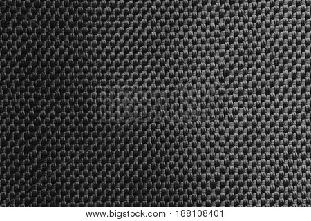 Dark gray fabric with light gradient. Top view