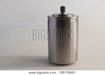 Small steel motor on a white background.