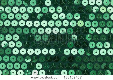 Green fabric with stitched circles. Top view