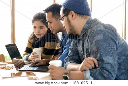 Business people working with digital tablet and laptop computer in coffee shop