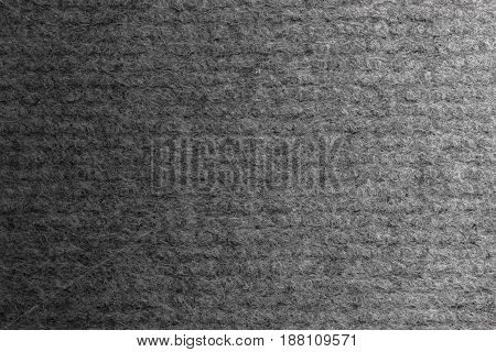 Gray carpet polyester texture. Gradient light. Top view