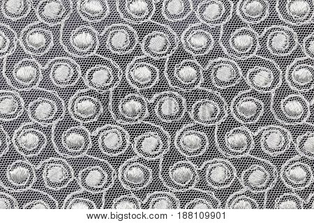 White fabric with spiral shapes. Top view