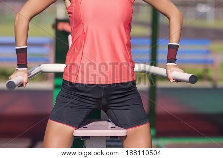 Closeup of Body of Professional Female Athlete In Outfit Having Fitness Workout Training Outdoor.Horizontal Image