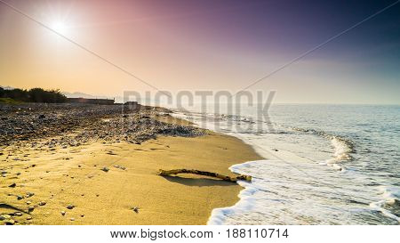 Sunset at desert island neverending golden coastline with color sky