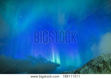 Amazing Picturesque Unique Northern Lights Aurora Borealis Over Lofoten Islands in Northern Part of Norway. Over the Polar Circle.Horizontal Image