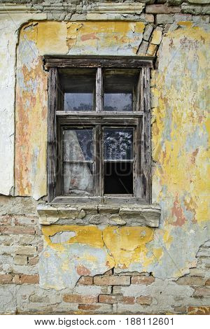 Old window on a farmhouse in Serbia who still resists time.