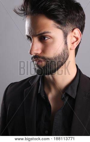 Handsome man with a low fade haircut on a white background