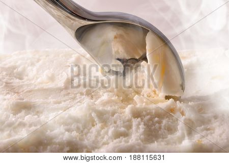 Making Vanilla Ice Cream With Scoop Close Up Elevated