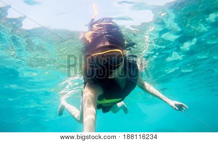 Woman snorkeling in the sea at Thailand