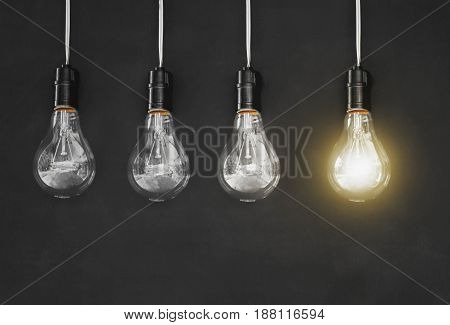 idea concept with light bulb and blackboard background